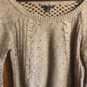 Grey light brown sweater with hole-details on back